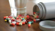 Close up shot of medicine capsule with wooden table background , Dolly shot right to left movement