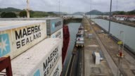 Close up shot of signage along the back of a large cargo ship reading MAERSK BALI as it passes through the Miraflores Locks of the Panama Canal in...