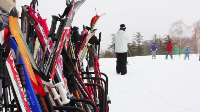 Close up shot of ski rack people in background