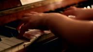 Close up shot of woman playing piano