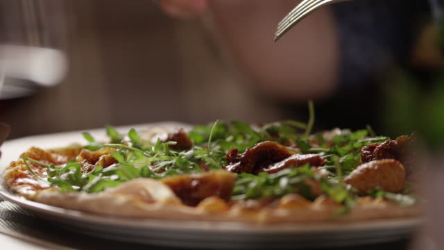 Close Up Shot Slicing Pizza 4K slow motion