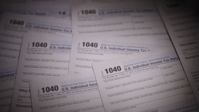 Close up shots of 1040 income tax forms arranged for a photo shoot in Tiskilwa Illinois US