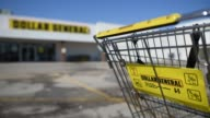 Close up shots of Dollar General signage and logos on a Dollar General shopping cart in the parking lot outside their Rock Island Illinois location...