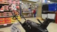 Close up shots of employees handling various products for sale at an Ace Hardware store in Peru Illinois Shot of a wall lined with DeWalt brand power...