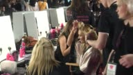 Close up shots of Victoria's Secret model applying make up and grooming their hair before a Victoria's Secret Fashion Show in 2014 Victoria's Secret...