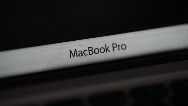 Close up signage for MacBook Pro is displayed on an Apple Inc laptop computer in an arranged video shot in Bangkok Thailand on Friday July 28 2017