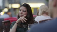 Close up slow motion shot of frustrated woman talking at restaurant / Berlin, Germany