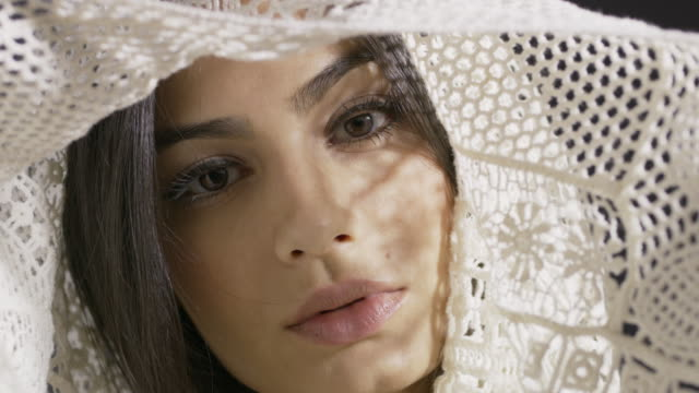 Close up slow motion shot of model posing with shawl / Cedar Hills, Utah, United States