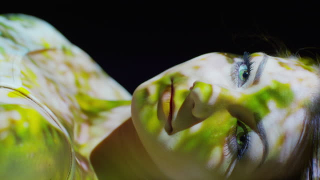 Close up slow motion shot of projections on woman's face / Cedar Hills, Utah, United States