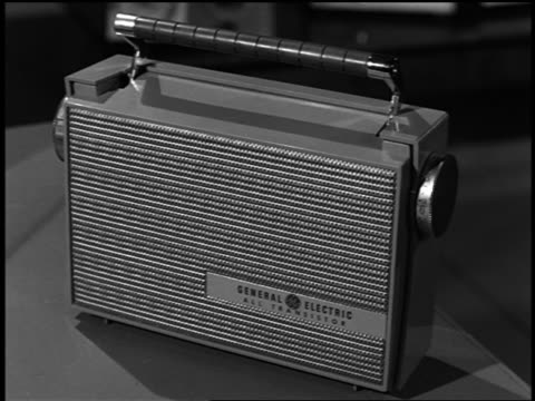 B/W 1957 close up small General Electric transistor radio on table