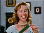 1950 close up smiling blonde woman pulling quarter from vacuum cleaner hose
