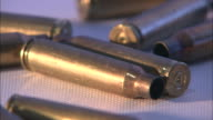 Close Up static - Brass cartridge casings lie on a flat surface /  Maryland, United States