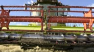 Close up the reel of a combine harvester sit idle at a farm near Drysdale Australia on Wednesday Feb 15 Harvested wheat sits in the blades of a...