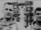 B/W 1967 close up PAN three astronauts in spacesuits outdoors / Apollo 1 crew / newsreel