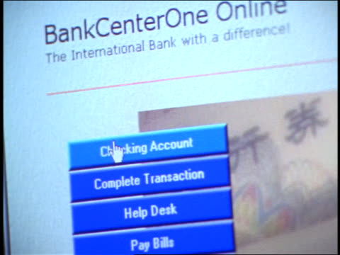 close up tilt down computer display with pointer highlighting buttons on online banking web page screen