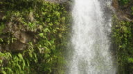 Close up, Tilt down, Waterfall, Lower Bouma Falls, cascading down mountain, shadow from waterfall on rock surface