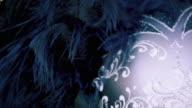 Close up tilting down shot of an elegant carnival mask.