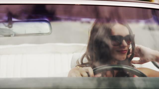 Close up tracking shot of beautiful woman driving convertible car / Pleasant Grove, Utah, United States