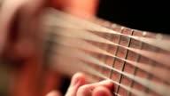 Close up video of guitarists hands macro