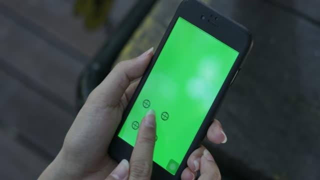 4K: Close up Woman Hand Using Smartphone Green Screen