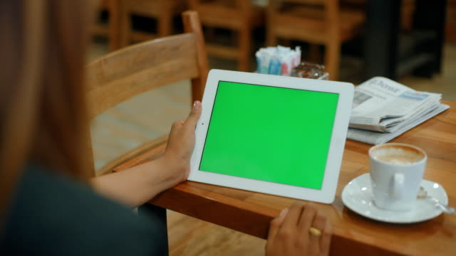 Close Up Woman holding a blank tablet PC with a green