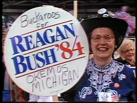 1984 close up woman in hat holding 'Reagan Bush '84' poster at Republican National Convention / Dallas