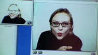 close up woman in split video displays on computer screen / one for live streaming + one for still images