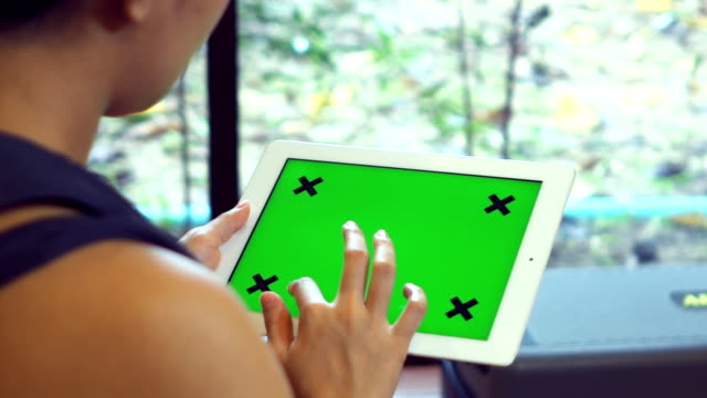 Close Up women Holding Blank Tablet PC With Green