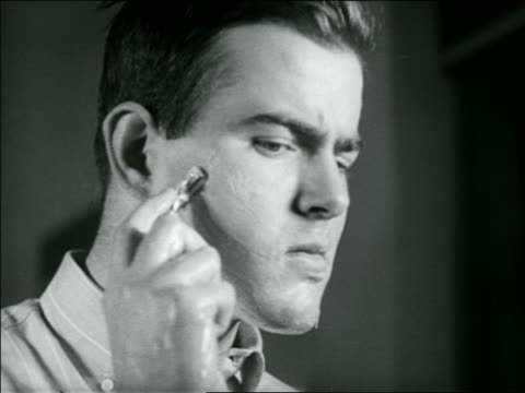B/W 1936 close up young man shaving face in shaving contest / newsreel