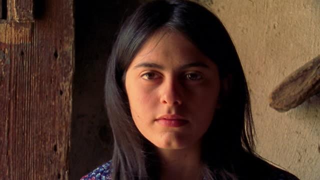 close up young woman posing indoors / Custonaci, Sicily