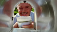 close up zoom in mail box point of view middle-aged man removing mail from mail box + looking happy