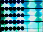 Close up zoom in zoom out time lapse rows of beads moving and pulsating on abacus