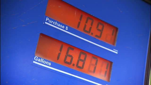 Close Up zoom,in , Digital displays tick the price of fuel and number of gallons at a gas pump. / Puerto Rico
