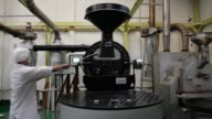 Close view of coffee beans being roasted by machine at Taman Delta Indonesia coffee factory in Semarang Indonesia on Thursday March 12 Roasted coffee...