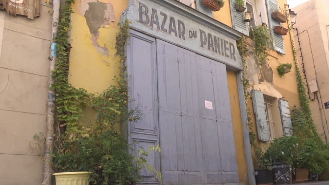 closed wooden door of  shop 'Bazar du Panier' in the old town