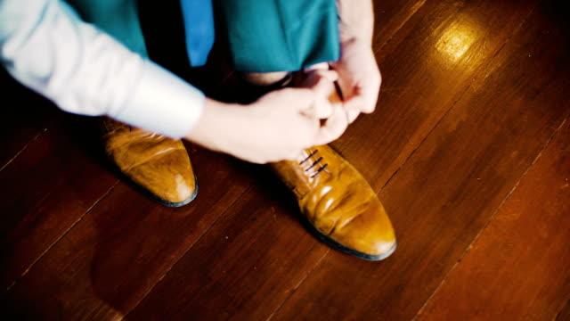 Close-up black shoes dressing
