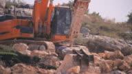 Closeup, Bulldozer at work , cutting rock