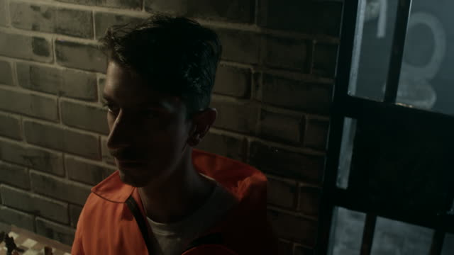 Close-up, convict on interrogation in prison