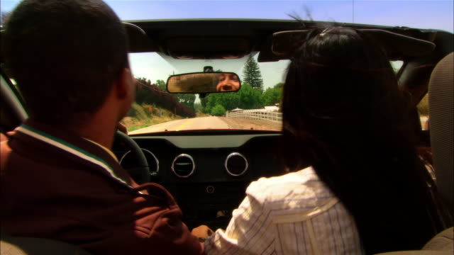 Close-up Couple driving in convertible through rural wine country / Paso Robles, California, USA