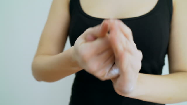 Close-up crane shot of female hands get creamed