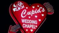 Close-up Cupid on heart-shaped chapel sign/ Las Vegas, Nevada, USA