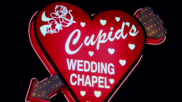 Close-up Cupid on heart-shaped chapel sign/ Las Vegas, Nevada, USA