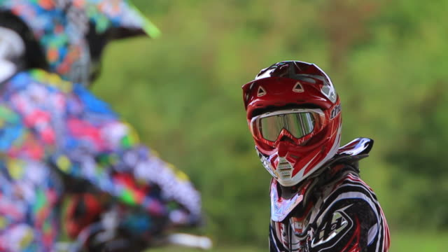 Close-up detail portrait of a motocross motorcycle rider.