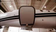 Close-up Door of private jet opening and closing in hangar at Opa Locka Airport/ Miami, Florida, USA