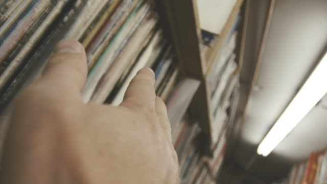 Closeup establishing shot of an antique record store.