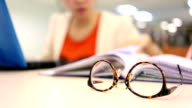 close-up eyeglasses, woman study education