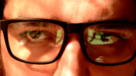 close-up eyes glasses man