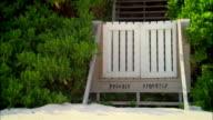 Close-up Fence reading Private Property on beach/ Harbor Island, Bahamas
