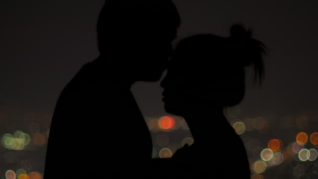 Close-up of a charming couple with bokeh background