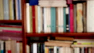 DOLLY: Closeup of a defocused Library